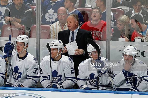 Head coach Randy Carlyle of the Toronto Maple Leafs looks on during third period action against the Florida Panthers at the BBT Center on December 28...