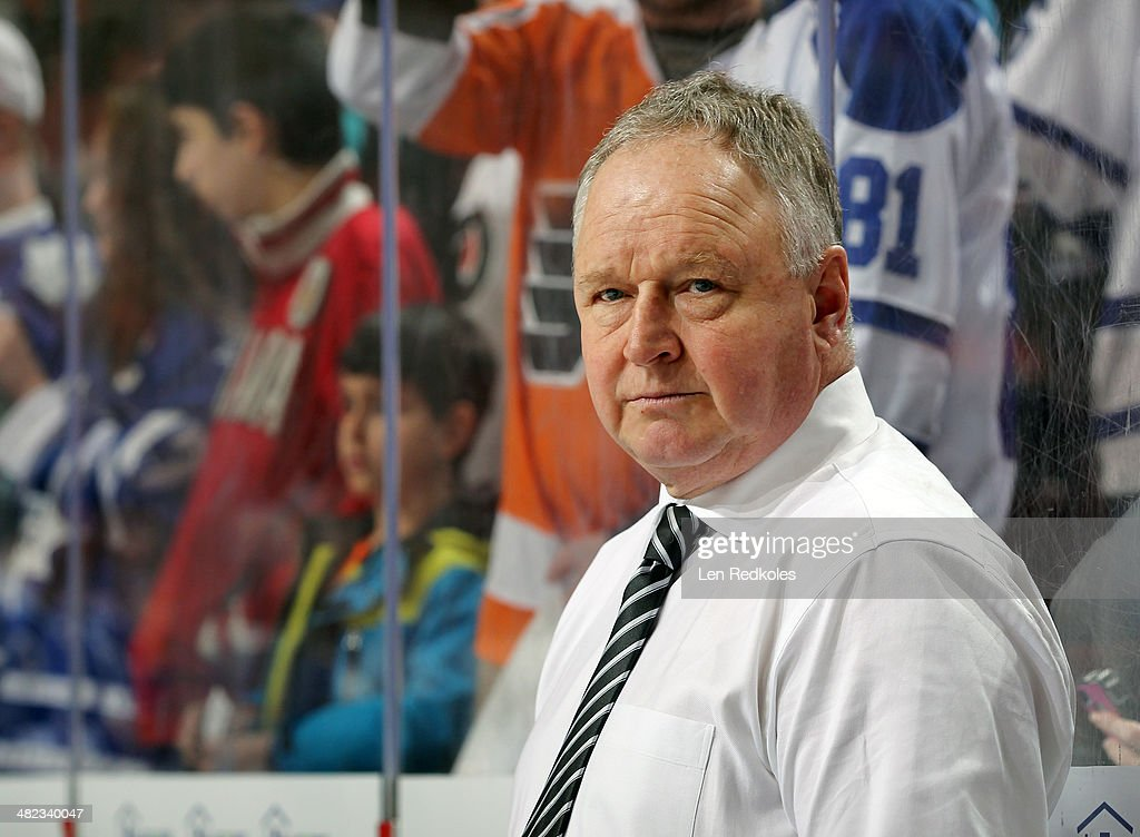 Head Coach <a gi-track='captionPersonalityLinkClicked' href=/galleries/search?phrase=Randy+Carlyle+-+Ice+Hockey+Coach&family=editorial&specificpeople=679108 ng-click='$event.stopPropagation()'>Randy Carlyle</a> of the Toronto Maple Leafs looks on during warm-ups prior to his game against the Philadelphia Flyers on March 28, 2014 at the Wells Fargo Center in Philadelphia, Pennsylvania.