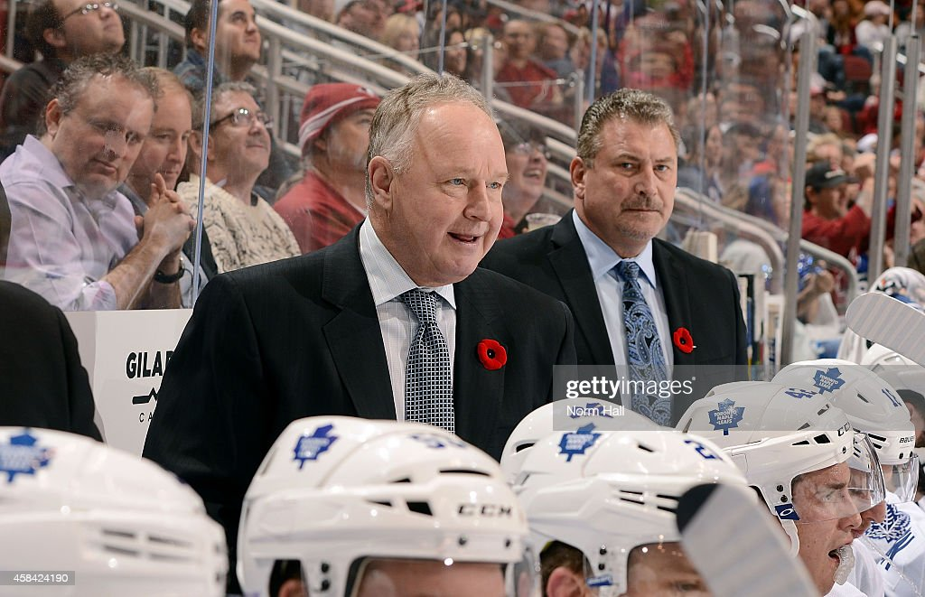 Head coach <a gi-track='captionPersonalityLinkClicked' href=/galleries/search?phrase=Randy+Carlyle+-+Ice+Hockey+Coach&family=editorial&specificpeople=679108 ng-click='$event.stopPropagation()'>Randy Carlyle</a> of the Toronto Maple Leafs looks on from the bench during third period action against the Arizona Coyotes at Gila River Arena on November 4, 2014 in Glendale, Arizona.