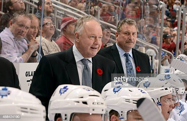 Head coach Randy Carlyle of the Toronto Maple Leafs looks on from the bench during third period action against the Arizona Coyotes at Gila River...