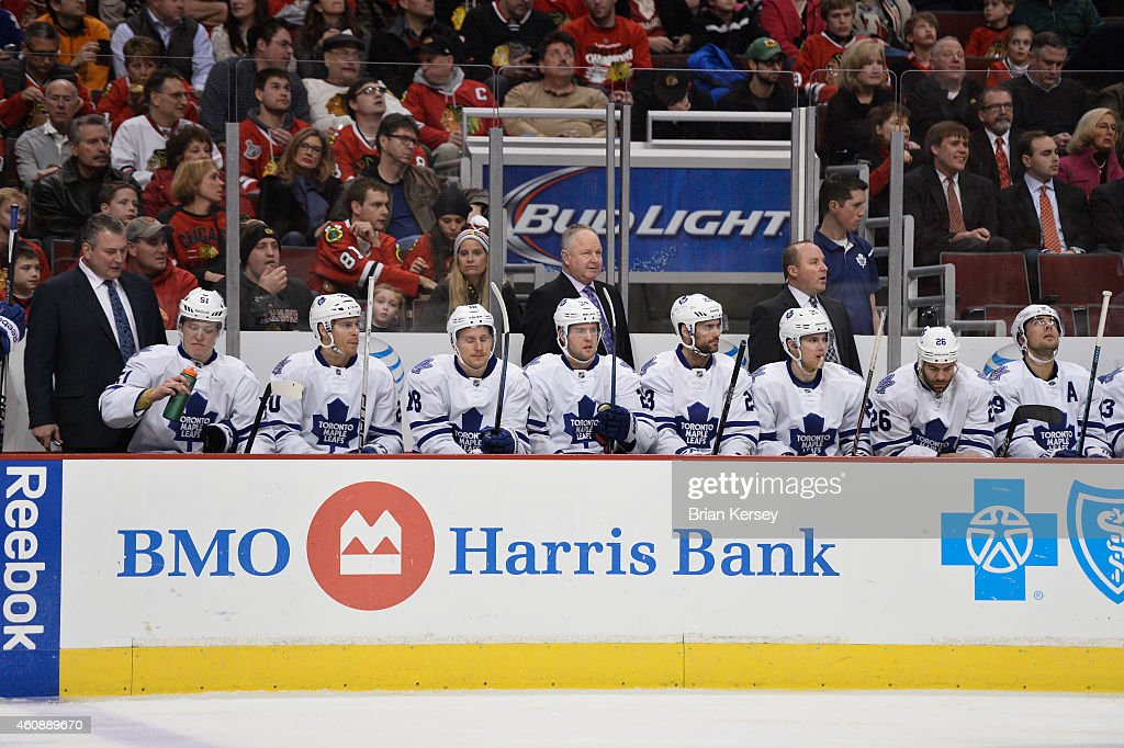 Head coach Randy Carlyle of the Toronto Maple Leafs stands on the bench against the Chicago Blackhawks during the first period at the United Center...