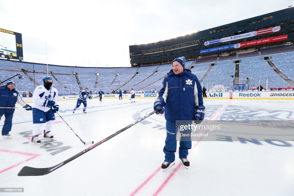 Head Coach <a gi-track='captionPersonalityLinkClicked' href=/galleries/search?phrase=Randy+Carlyle+-+Ice+Hockey+Coach&family=editorial&specificpeople=679108 ng-click='$event.stopPropagation()'>Randy Carlyle</a> of the Toronto Maple Leafs takes the ice during 2014 Bridgestone NHL Winter Classic team practice session on December 31, 2013 at Michigan Stadium in Ann Arbor, Michigan.