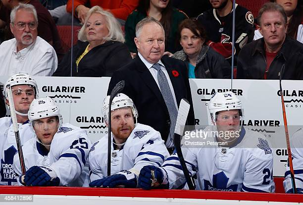 Head coach Randy Carlyle of the Toronto Maple Leafs watches from the bench during the NHL game against the Arizona Coyotes at Gila River Arena on...
