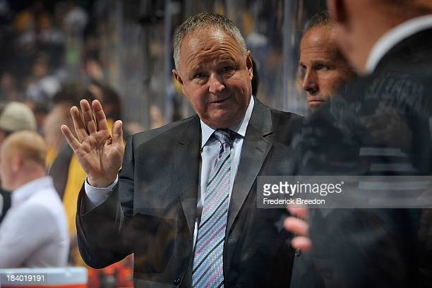 Head coach Randy Carlyle of the Toronto Maple Leafs watches his team play against the Nashville Predators at Bridgestone Arena on October 10 2013 in...