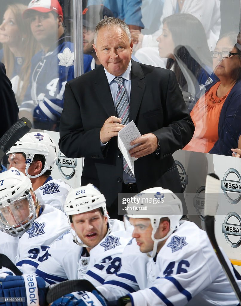 Head coach Randy Carlyle of the Toronto Maple Leafs watches play against of the Nashville Predators at Bridgestone Arena on October 10 2013 in...