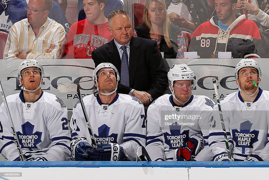 Head Coach <a gi-track='captionPersonalityLinkClicked' href=/galleries/search?phrase=Randy+Carlyle+-+Ice+Hockey+Coach&family=editorial&specificpeople=679108 ng-click='$event.stopPropagation()'>Randy Carlyle</a> of the Toronto Maple Leafs watches the action from the bench during the game against the Florida Panthers at the BB&T Center on December 28, 2014 in Sunrise, Florida.