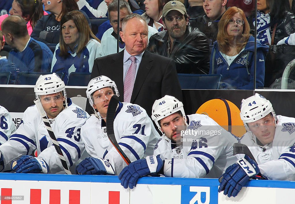 Head coach <a gi-track='captionPersonalityLinkClicked' href=/galleries/search?phrase=Randy+Carlyle+-+Ice+Hockey+Coach&family=editorial&specificpeople=679108 ng-click='$event.stopPropagation()'>Randy Carlyle</a> of the Toronto Maple Leafs watches the action against the Buffalo Sabres on November 15, 2014 at the First Niagara Center in Buffalo, New York.