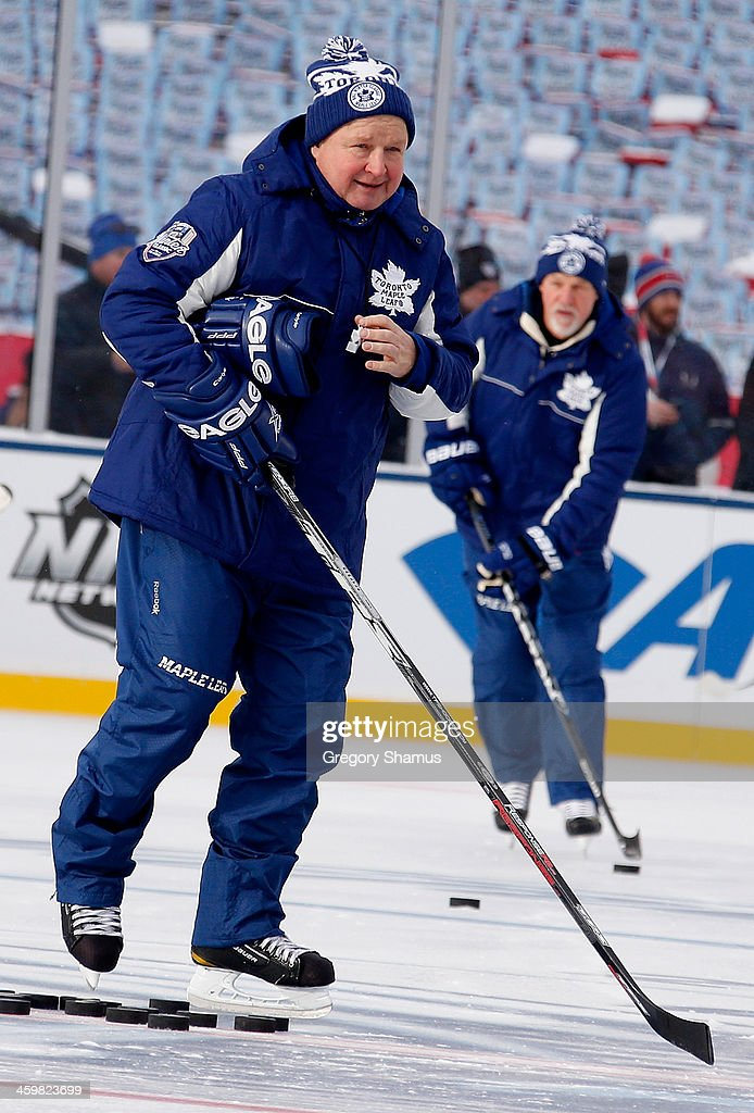 Head coach Randy Carlyle of the Toronto Maple Leafs works out his team the day before the 2014 Bridgestone NHL Winter Classic at Michigan Stadium on...