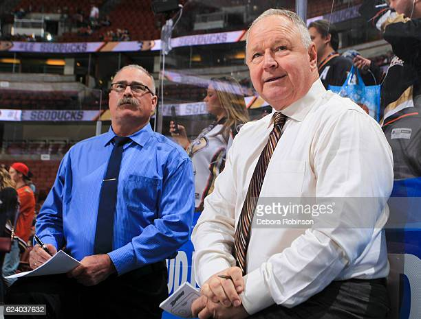 Head coach Randy Carlyle right and assistant coach Paul MacLean of the Anaheim Ducks watch warmup before the game against the New Jersey Devils at...