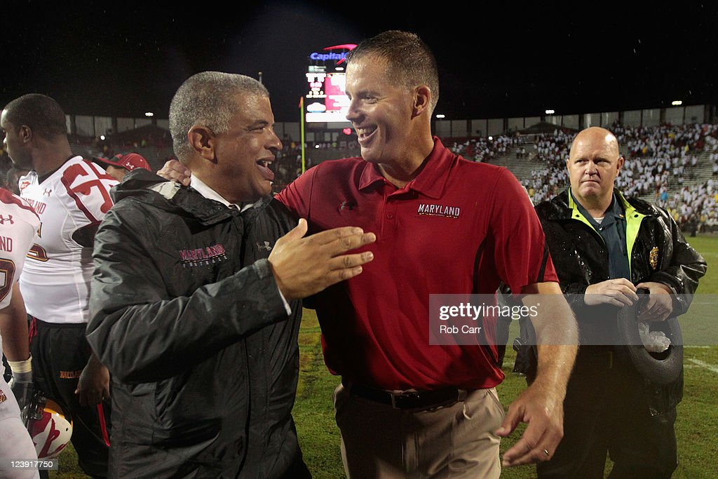 Head coach <a gi-track='captionPersonalityLinkClicked' href=/galleries/search?phrase=Randy+Edsall&family=editorial&specificpeople=2160091 ng-click='$event.stopPropagation()'>Randy Edsall</a> (R) is congratulated by athletic director Kevin Anderson (L) after the Terrapins defeated the Miami Hurricanes 32-24 at Byrd Stadium on September 5, 2011 in College Park, Maryland.