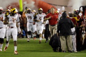 Head coach Randy Edsall of Maryland Terrapins runs onto the field before the start of the Terrapins game against the Miami Hurricanes at Byrd Stadium...