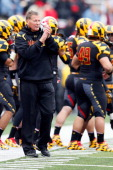 Head coach Randy Edsall of the Maryland Terrapins applauds his team from the sideline during the first half of the Terapins 3313 loss to the Georgia...