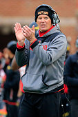Head coach Randy Edsall of the Maryland Terrapins appluades from the sidelines after the Terrapins scored a first half touchdown against the Rutgers...