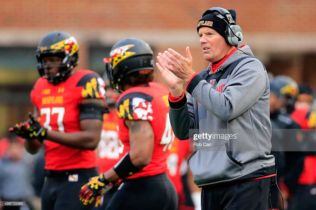 Head coach <a gi-track='captionPersonalityLinkClicked' href=/galleries/search?phrase=Randy+Edsall&family=editorial&specificpeople=2160091 ng-click='$event.stopPropagation()'>Randy Edsall</a> of the Maryland Terrapins appluades from the sidelines after the Terrapins scored a first half touchdown against the Rutgers Scarlet Knights at Byrd Stadium on November 29, 2014 in College Park, Maryland.