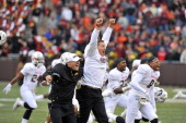 Head coach Randy Edsall of the Maryland Terrapins celebrates a victory against the Virginia Tech Hokies at Lane Stadium on November 16 2013 in...