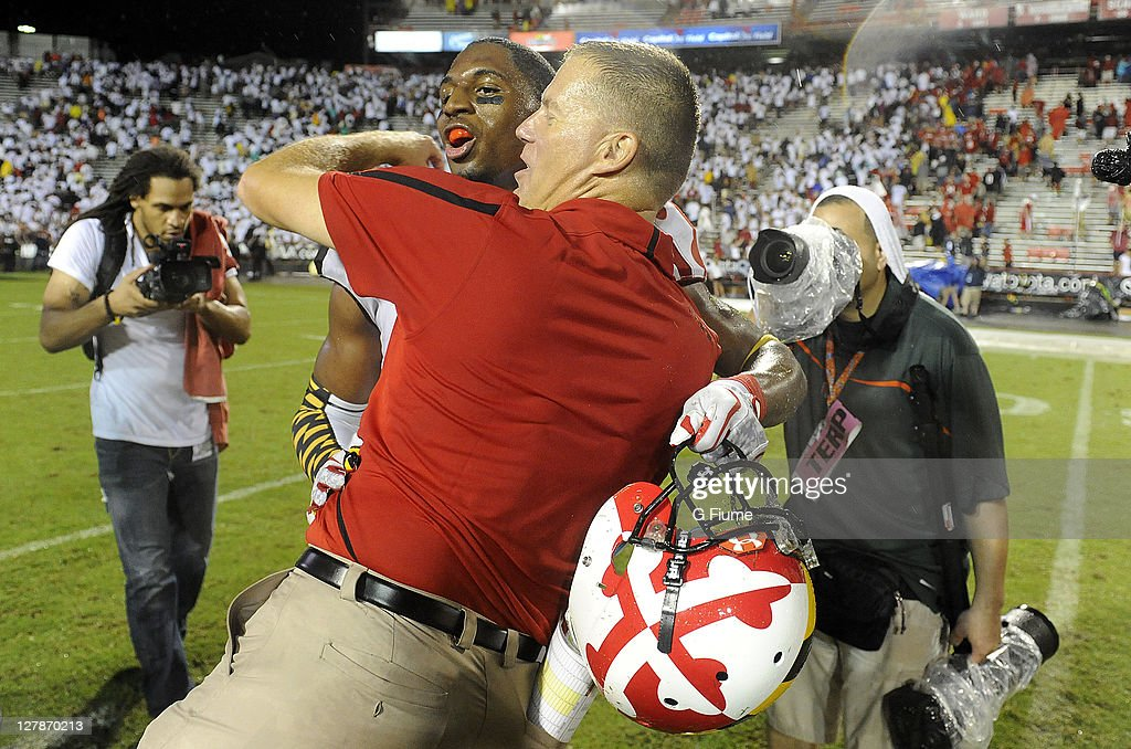 Head coach Randy Edsall of the Maryland Terrapins celebrates With Kenny Tate after a victory against the Miami Hurricanes at Byrd Stadium on...