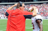 Head coach Randy Edsall of the Maryland Terrapins celebrates with Kerry Boykins during the game against the Temple Owls at Lincoln Financial Field on...