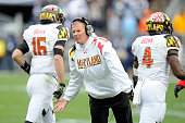 Head coach Randy Edsall of the Maryland Terrapins congratulates CJ Brown and Wes Brown after a touchdown against the Penn State Nittany Lions at...