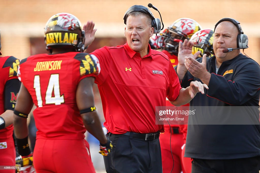 Head coach Randy Edsall of the Maryland Terrapins greets his defense after they made a goalline stand during the second half of their 5224 loss to...