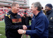 Head coach Randy Edsall of the Maryland Terrapins shakes hands with head coach Paul Johnson of the Georgia Tech Yellow Jackets following the Yellow...