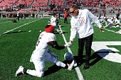 Head coach Randy Edsall of the Maryland Terrapins shakes hands with Wes Brown before the game against the Ohio State Buckeyes at Ohio Stadium on...