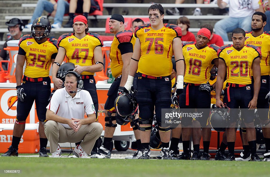Head coach Randy Edsall of the Maryland Terrapins squats on the sidelines during the closing moments of the Terrapins 387 loss to the Temple Owls at...