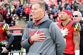 Head coach Randy Edsall of the Maryland Terrapins stands for the national anthem before the game against the Rutgers Scarlet Knights at Byrd Stadium...
