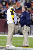 Head coach Randy Edsall of the Maryland Terrapins talks with head coach Brian Kelly of the Notre Dame Fighting Irish at FedEx Field on November 12...