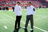 Head Coach Randy Edsall of the Maryland Terrapins talks with Head Coach Urban Meyer of the Ohio State Buckeyes before the game at Ohio Stadium on...