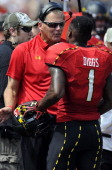 Head coach Randy Edsall of the Maryland Terrapins talks with Stefon Diggs during the game against the Florida International Golden Panthers at Byrd...