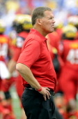 Head Coach Randy Edsall of the Maryland Terrapins watches the teams warm up before the game against the West Virginia Mountaineers at MT Bank Stadium...