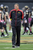 Head coach Randy Edsall of the Maryland Terrapins watches the teams warm up before the game against the Wake Forest Demon Deacons at BBT Field on...
