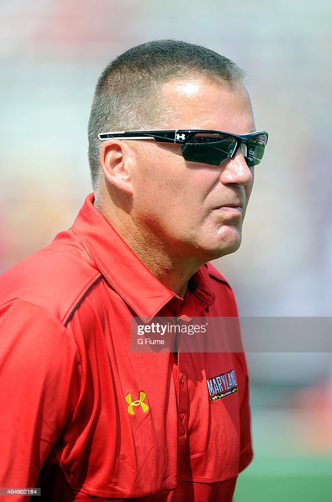 Head coach Randy Edsall of the Maryland Terrapins watches warm ups before the game against the James Madison Dukes at Byrd Stadium on August 30 2014...