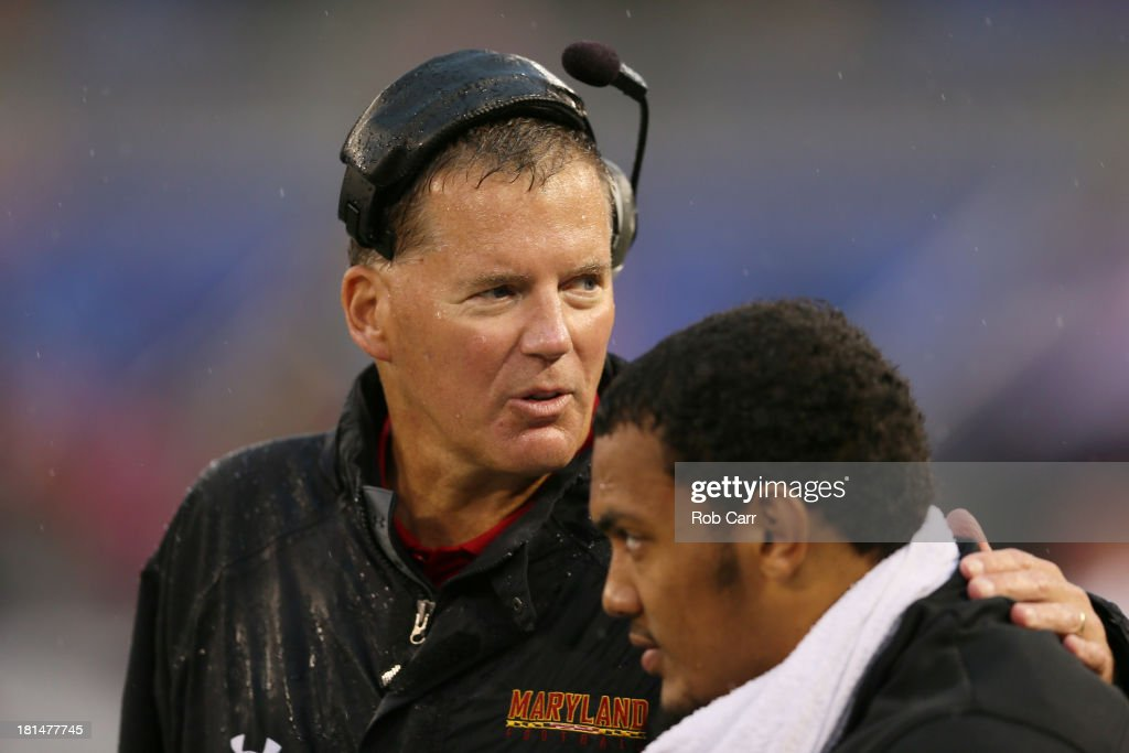 Head coach <a gi-track='captionPersonalityLinkClicked' href=/galleries/search?phrase=Randy+Edsall&family=editorial&specificpeople=2160091 ng-click='$event.stopPropagation()'>Randy Edsall</a> talks with linebacker Alex Twine #35 of the Maryland Terrapins during the fourth quarter of their 37-0 win over the West Virginia Mountaineers at M&T Bank Stadium on September 21, 2013 in Baltimore, Maryland.