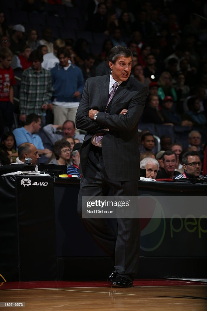 Head Coach <a gi-track='captionPersonalityLinkClicked' href=/galleries/search?phrase=Randy+Wittman&family=editorial&specificpeople=679109 ng-click='$event.stopPropagation()'>Randy Wittman</a> of the Washington Wizards directs his team against the Miami Heat during the pre-season game at the Verizon Center on October 15, 2013 in Washington, DC.