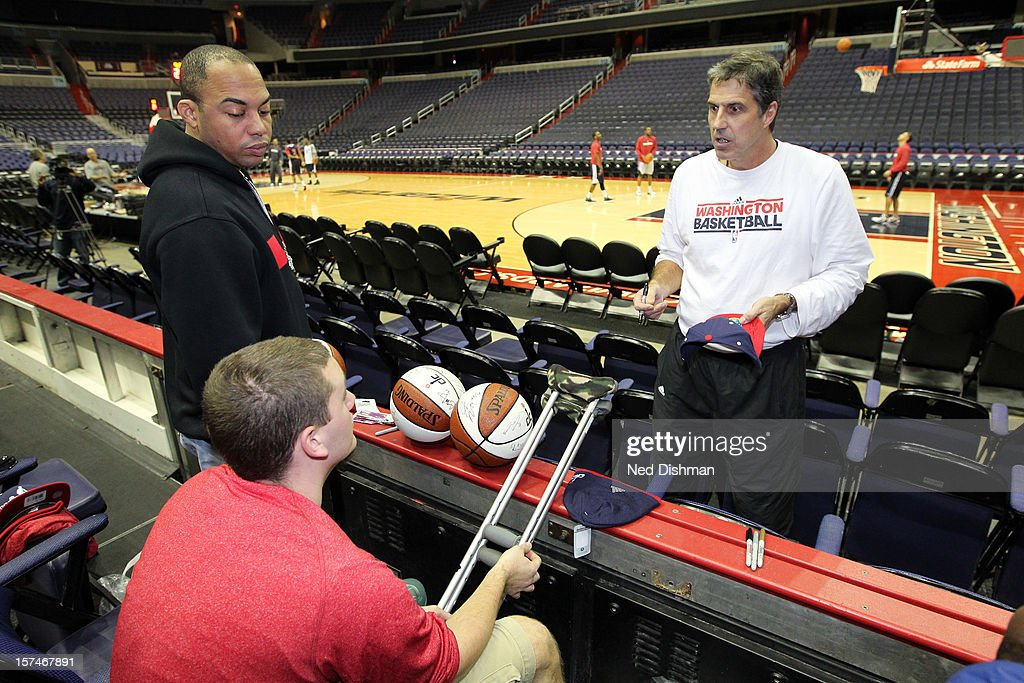 Head coach Randy Wittman of the Washington Wizards greets wounded warriors from Walter Reed after watching practice on December 3, 2012 at the Verizon Center in Washington, DC.