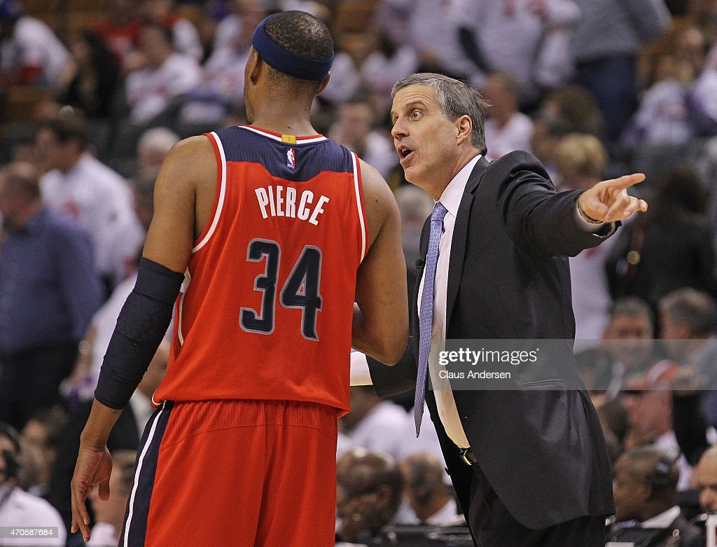 Head coach Randy Wittman of the Washington Wizards has some words for Paul Pierce late in the game against the Toronto Raptors in Game Two of the...