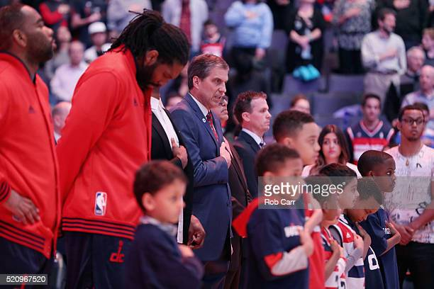 Head coach Randy Wittman of the Washington Wizards listens to the national anthem before the start of their game against the Atlanta Hawks at Verizon...