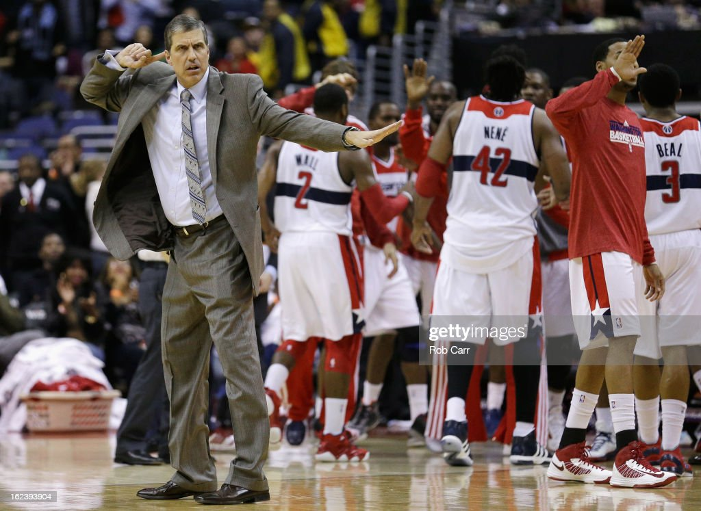Head coach Randy Wittman of the Washington Wizards motions from the floor during a timeout against the Denver Nuggets during the second half at Verizon Center on February 22, 2013 in Washington, DC.