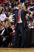 Head coach Randy Wittman of the Washington Wizards motions from the bench in the second quarter against the Toronto Raptors during Game Three of the...