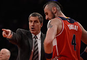 Head Coach Randy Wittman of the Washington Wizards speaks to Marcin Gortat during their game against the New York Knicks at Madison Square Garden on...