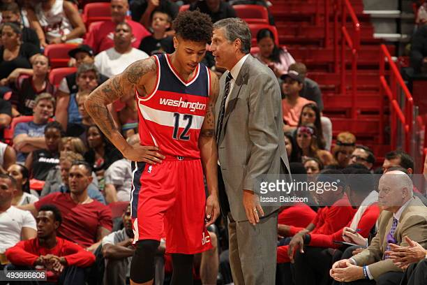 Head Coach Randy Wittman of the Washington Wizards talks with Kelly Oubre Jr #12 during the game against the Miami Heat on October 21 2015 at...
