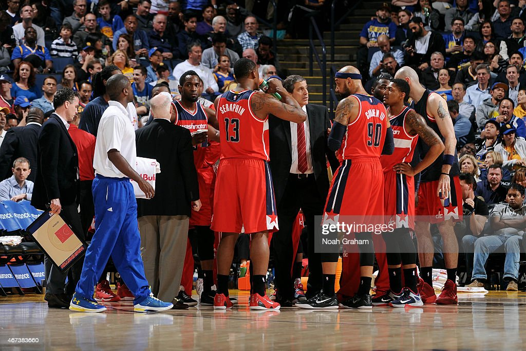 Head Coach Randy Wittman speaks with the Washington Wizards players during a timeout against the Golden State Warriors on March 23 2015 at Oracle...