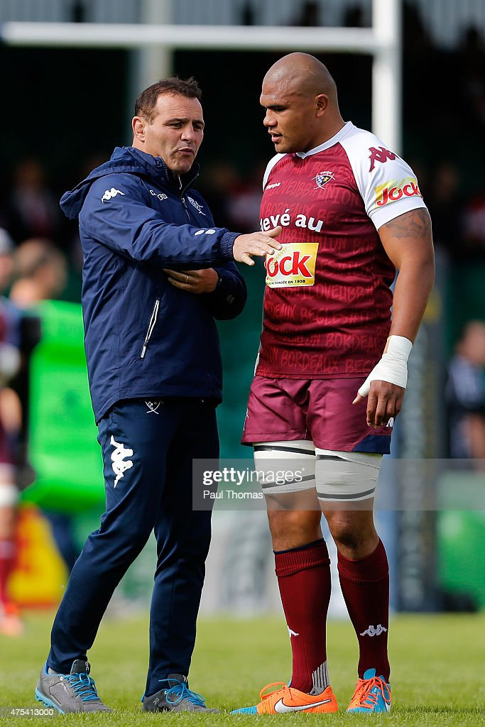 Head coach Raphael Ibanez (L) of Bordeaux speaks to his player Peter Saili before the European Champions Cup Play-Off match between Gloucester Rugby and Bordeaux-Begles at Sixways Stadium on May 31, 2015 in Worcester, England. (Photo by Paul Thomas/Getty Images) Raphael Ibanez; Peter Saili