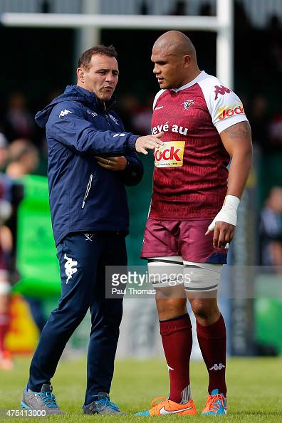Head coach Raphael Ibanez of Bordeaux speaks to his player Peter Saili before the European Champions Cup PlayOff match between Gloucester Rugby and...
