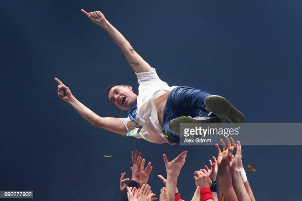Head coach Raul Gonzalez Gutierrez of Vardar is thrown into the air as his team celebrate winning the VELUX EHF FINAL4 final between Paris...