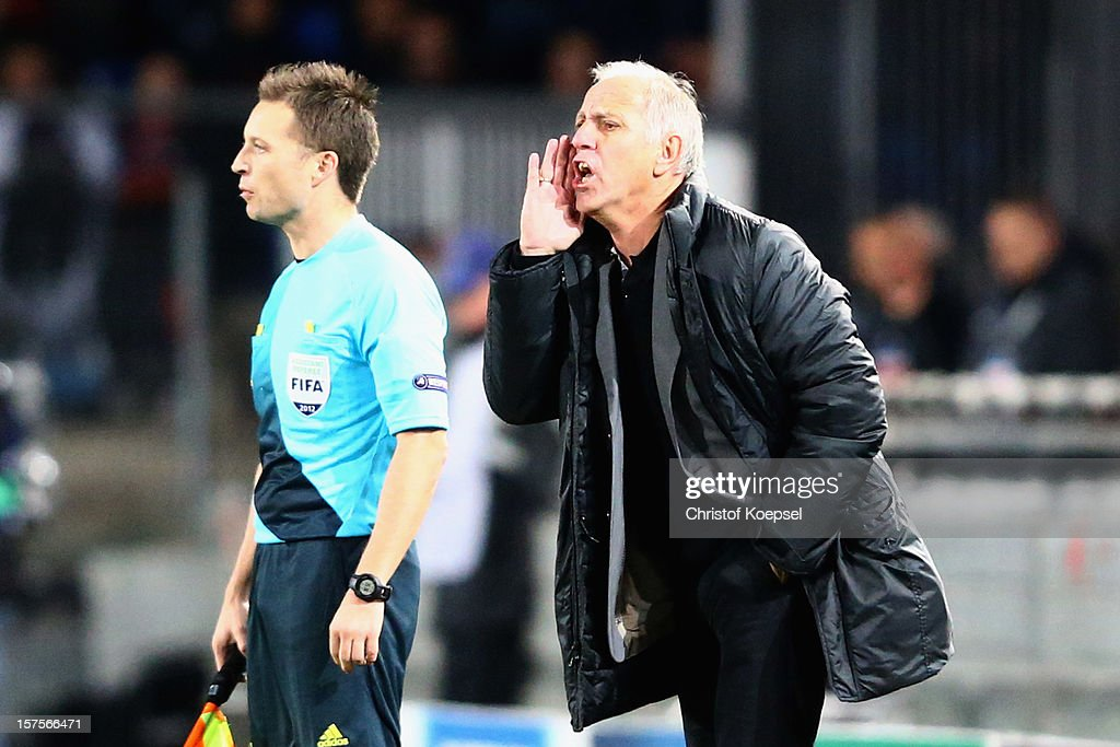 Head coach Rene Girard of Montpellier issues instructions during the UEFA Champions League group B match between Montpellier Herault SC and FC Schalke 04 at Stade de la Mosson on December 4, 2012 in Montpellier, France.