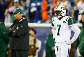 Head coach Rex Ryan and Geno Smith of the New York Jets look on before a game against the New England Patriots at Gillette Stadium on October 16 2014...