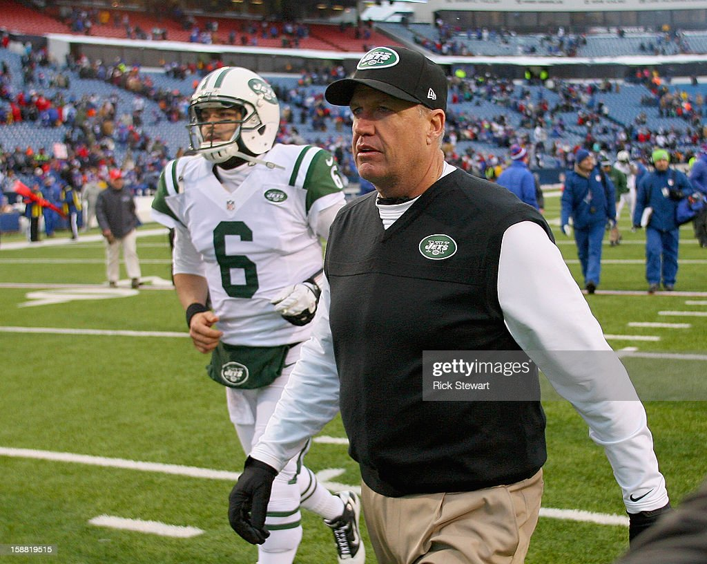 Head coach <a gi-track='captionPersonalityLinkClicked' href=/galleries/search?phrase=Rex+Ryan&family=editorial&specificpeople=2358658 ng-click='$event.stopPropagation()'>Rex Ryan</a> and <a gi-track='captionPersonalityLinkClicked' href=/galleries/search?phrase=Mark+Sanchez&family=editorial&specificpeople=690406 ng-click='$event.stopPropagation()'>Mark Sanchez</a> #6 of the New York Jets walk off the field after losing to the Buffalo Bills 28-9 at Ralph Wilson Stadium on December 30, 2012 in Orchard Park, New York.