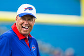 Head coach Rex Ryan of the Buffalo Bills laughs with players before the game against the Carolina Panthers on August 14 2015 at Ralph Wilson Stadium...